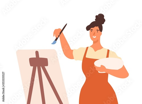 Obraz Happy artistic female in apron drawing picture use paint vector flat illustration. Smiling woman professional painter stand in front of easel isolated on white. Girl enjoy art painting at workshop - fototapety do salonu