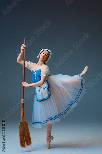 Платно Young and graceful female ballet dancer as Cindrella fairytail character on studio background