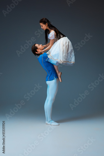 Young and graceful ballet dancers as Cindrella fairytail characters on studio background фототапет