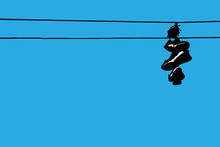 Sneakers Hanging On Wires Agai...