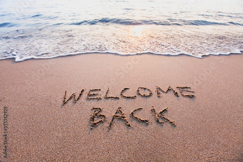 Fototapeta welcome back, text on sand beach, tourism after pandemic concept