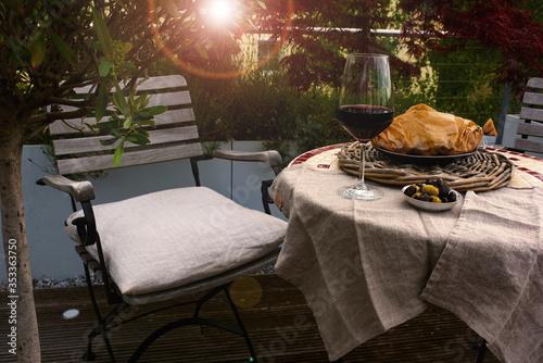 Fotografie, Obraz Dinner on garden terrace