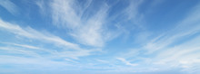 Blue Sky With Beautiful Wispy Clouds. Panoramic Background.