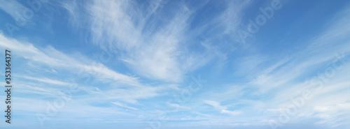 Blue sky with beautiful wispy clouds. Panoramic background. Fototapeta