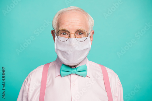 Obraz Close-up portrait of his he funky hipster elderly guy wearing gauze mask respiratory influenza flu flue grippe prevention isolated bright vivid shine vibrant teal turquoise blue grren color background - fototapety do salonu