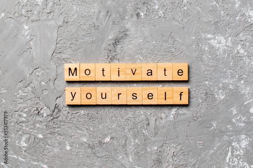 Photo motivate yourself word written on wood block
