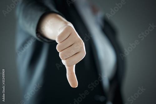 Female thumb down close-up on the background of suit in blur Canvas-taulu