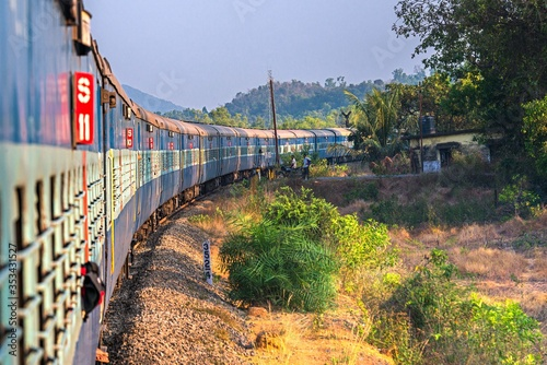 India, Maharashtra, Perspective view and curve of Indian train at the dawn Wallpaper Mural