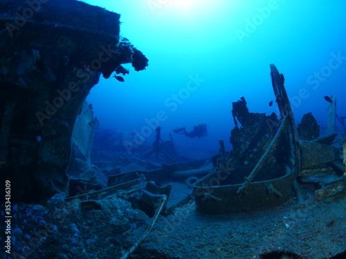scuba divers exploring ship wreck scenery underwater shipwreck metal on the ocea Canvas Print
