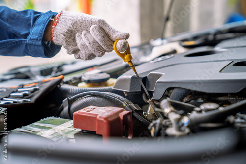Fotografija Auto mechanic working in the garage, Service and maintenance and car maintenance