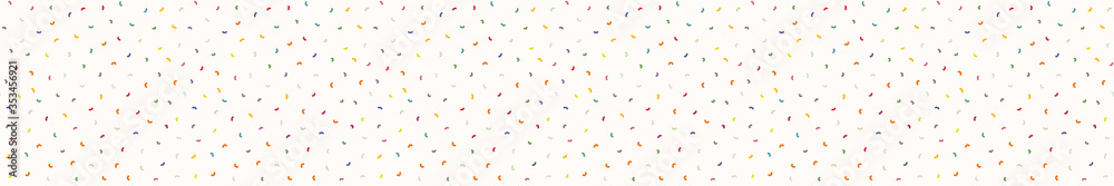 Fototapeta Sparse confetti dotty border texture seamless background. Tiny colored flecked sprinkles ribbon trim edge banner. Modern cute falling speckle pattern. Japanese kawaii minimal digital party washi tape.