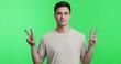Leinwandbild Motiv Cheerful man showing double v sign, peace gesture