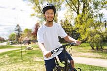 Boy Riding Bike Wearing A Helmet Outside