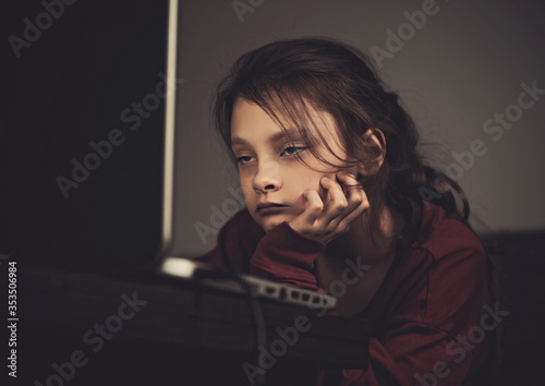 Very tired wanting to sleep kid girl sitting  and looking on computer monitor at home Canvas
