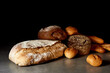 Freshly baked bakery products on a gray surface. Black background.