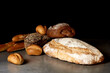 Fresh pastries in assortment on a gray surface. Black background.