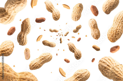 Obraz Collection of peanuts falling isolated on white background. Selective focus - fototapety do salonu