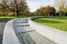 Princess Diana Memorial Fountain Surrounded By Greenery Under The Sunlight In London, England