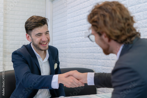 Business caucasian men handshake for sponsorship deal Canvas Print