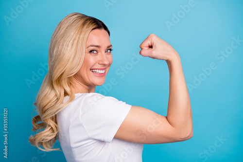 Closeup profile photo of attractive lady wavy blond hairdo raise arm showing big Canvas Print