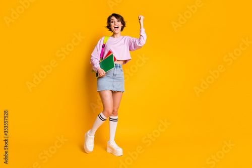Obraz Full length body size view of her she nice attractive lovely cheerful cheery girl holding in hand materials celebrating a-mark holiday isolated on bright vivid shine vibrant yellow color background - fototapety do salonu