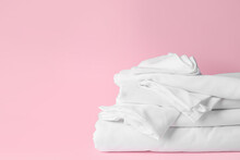 Stack Of Clean Bed Sheets On C...