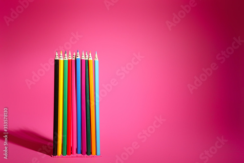 Obraz Colorful pencils with drawn faces on pink background. Unity concept - fototapety do salonu