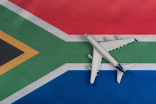 National Flag Of Republic Of South Africa And Toy Airplane Close Up. Resumption Of Flights After Quarantine.