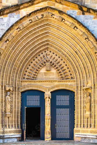 Entrance door and main facade of old stone church in Guernica, Basque Country, Spain Canvas Print