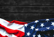 American Flag on black wooden background with top view and copy space.