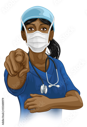 Fotografía A woman nurse or doctor in surgical or hospital scrubs and mask pointing in a your country needs or wants you gesture