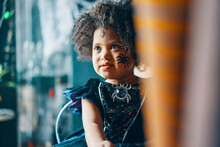 A Child With Dark Curly Hair I...