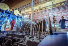 Engineers Inspecting A Turbine...