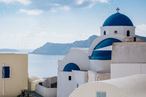 Fototapety, obrazy: White church with blue dome in Oia village, Santorini island, Greece.