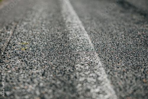 Asphalt road with an abraded white line mark Canvas Print