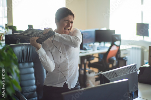 Canvas A woman freaks out and gets depressed from a mistake and breaks the keyboard on the monitor