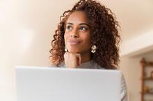 Woman Thinking Behind Laptop