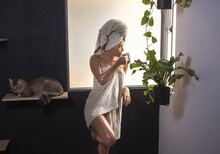 Woman In Towel With Her Cat Dr...