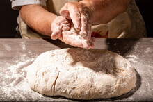 Hands Of Granny Kneads Dough. ...