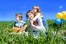 Children In A Field On Picnic....