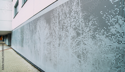 Valokuva Abstract perforated gray metal panel. Trees pattern