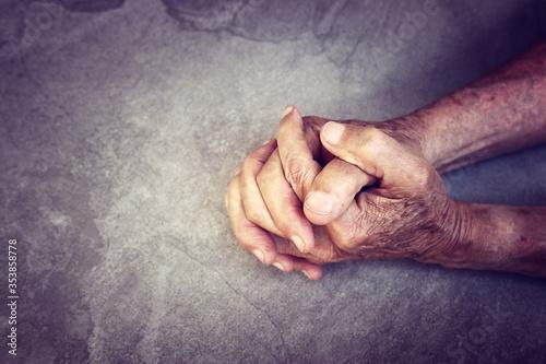 Fototapeta close up image of senior male hands over table