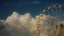 Ferris Wheel Against Blue Sky ...