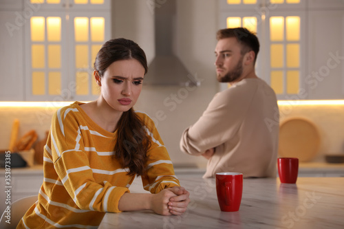 Photo Young couple quarreling at home. Jealousy in relationship