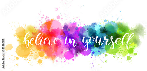 Photo Typography watercolored background with handwritten inspirational text : Believe