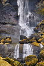 Icelandic Waterfall And Moss Covered Rocks