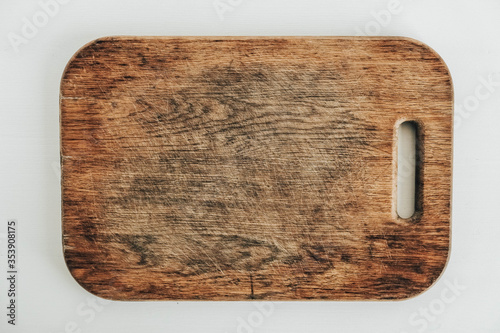 Vászonkép Old wooden cutting board on a white background
