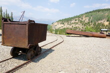 Steel Ore Cart Sits On A Railing Outside Of The Mine