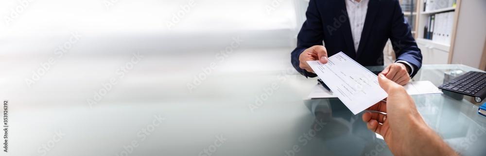Fototapeta Businessman Giving Cheque