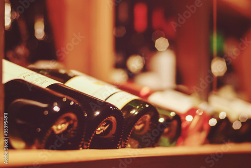 bottles of wine on the shelves of wine bar and wine shop Wallpaper Mural